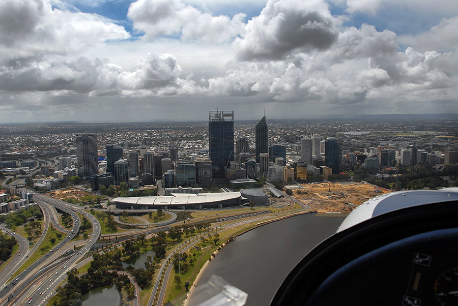 Scenic flight over Perth water overlooking centre of the city